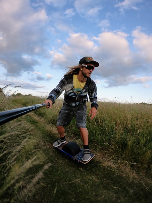 Customer Owain Hughes riding his Onewheel XR through the Sussex fields off road with a go pro all purchased from Ride and Glide