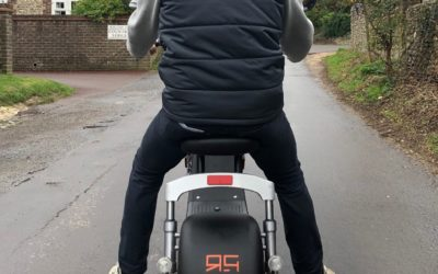 Rear shot of Peter Line riding the Skotero Humley Electric Motorcycle/scooter on the road in Worthing, West Sussex, purchased at Ride and Glide Limited