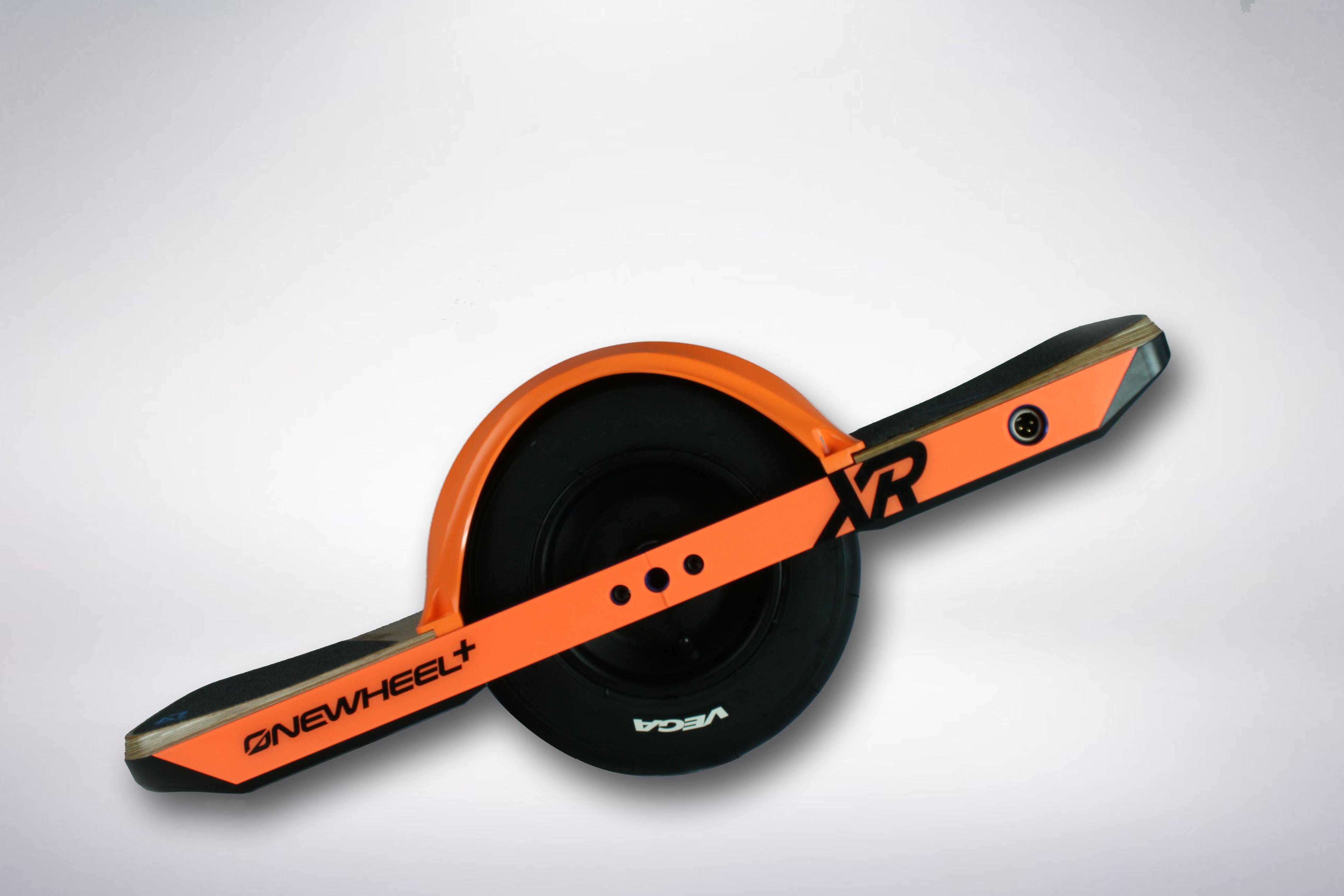 Onewheel XR with orange rail guard and orange fender